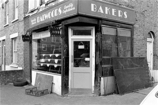 Bagshot Street, c1988. Dalwoods Bakers on the corner with Smyrk's Road.  X.png