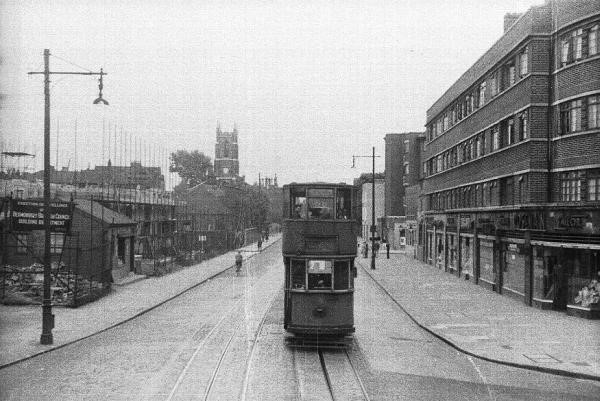 Tram in Jamaica Road Southwark park road is in the right had side and west lane is on the left. The tram is coming from Rotherhithe Tunnel way..jpg