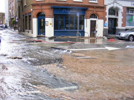 Sandbags had been placed in front of the doors of Magdalen restaurant in Tooley Street as water flowed down Shand Street..jpg