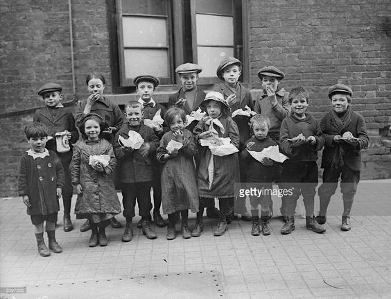 Children eating a penny's worth of Plum Duff from soup kitchens in Bermondsey….jpg