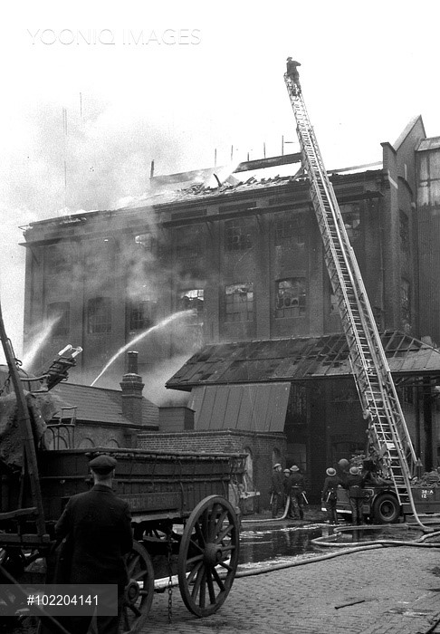 Firefighters attacking a blaze in Bricklayers Arms Goods Depot in the Old Kent Road.jpg