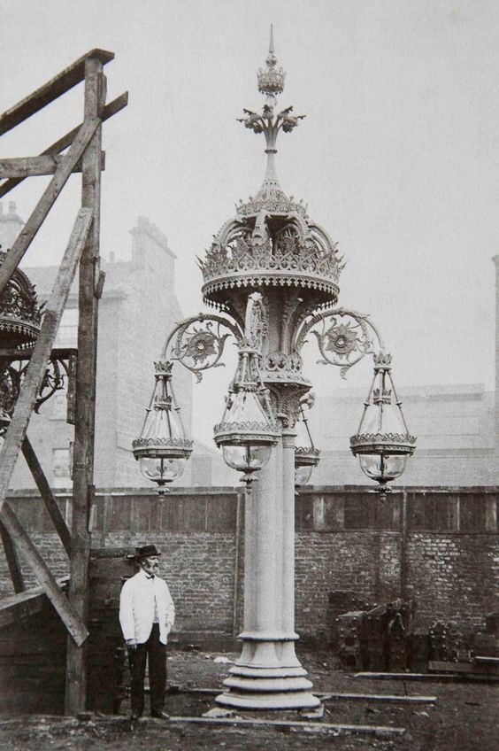 Photograph of the cast iron lamp and manufacturer Walter Macfarlane, prior to its installation in Southwark Street, c1865. junction with Borough High Street.jpg