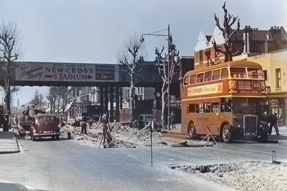 Junction of Pomroy Street and Old Kent Road in 1953. This is New Cross Rd,Old Kent Rd ends the other side of bridge..jpg