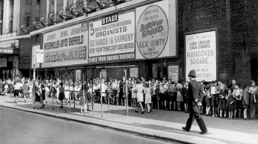 A long queue of children waiting outside the popular Trocadero in the 1940s.jpg