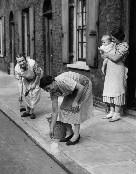 1939 Housewives of Roupell Street, London, painting kerbs white to help night time traffic during WW II, near Waterloo X.jpg