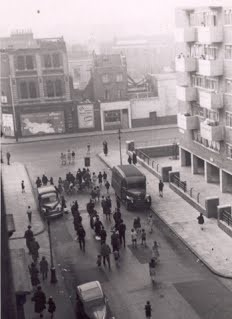 Scovell Road looking West from bedroom window of flat 233 Scovell Rd c1958. War damaged pub the Britannia can be seen along with Lew's Fish & Chip Shop..jpg