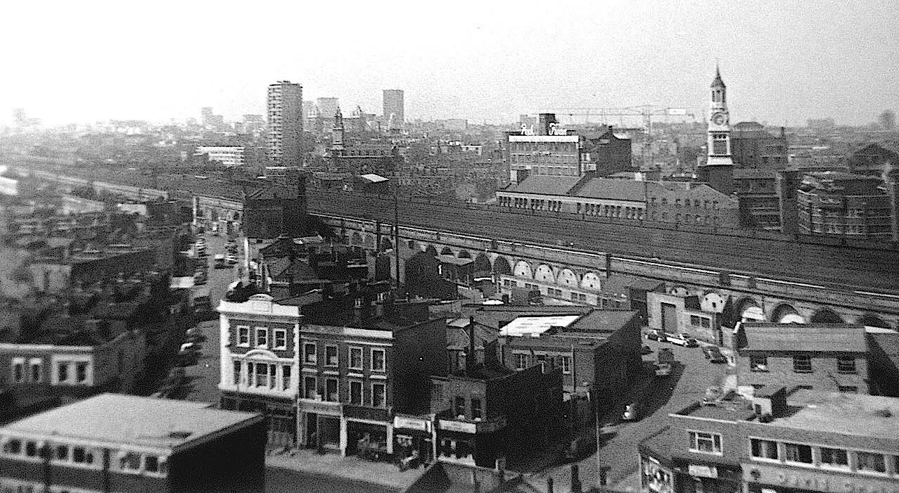 The Blue, Southwark Park Road in foreground, white building the Blue Anchor Pub, corner of Blue Anchor Lane (left) Bombay Street to the right. Peak Freans Biscuit Factory in background..jpg