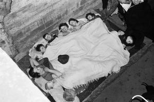 O'Rourke family of St James's Road, Bermondsey, sleep under a blanket in an air raid shelter under the railway arches, probably at Dockley Road, Bermondsey in November 1940  X.jpg