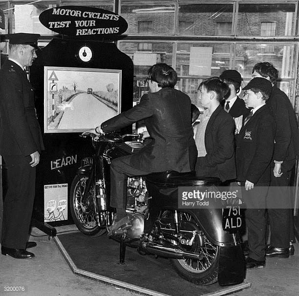 Boys from Bermondsey trying a new road safety machine at their local police station (the Simulator.).jpg