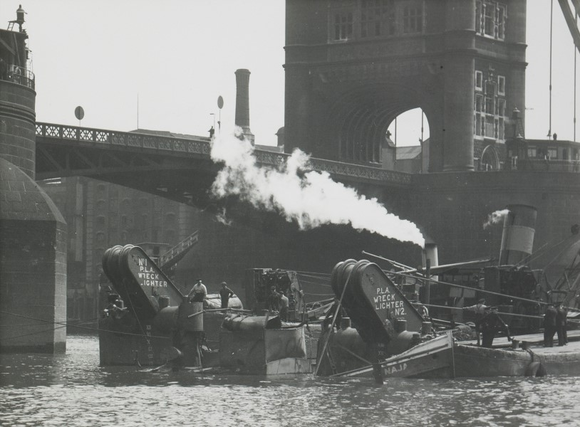 City bomb damage, wreck lighters raising the tug 'Naga', Tower Bridge, 12th July 1944  X.jpg