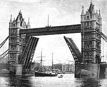 Quest going under Tower Bridge c 1921.jpg