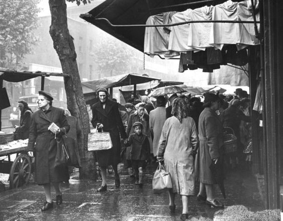 Tower Bridge Road street market, Bermondsey. 1949 Shoppers in the rain.  X.jpg