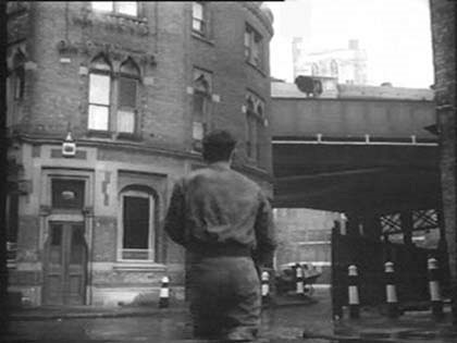 Film Pool of London 1951 Southwark Cathedral looming over the railway arch. Stoney Street. Bedale Street and Green Dragon Court..jpg