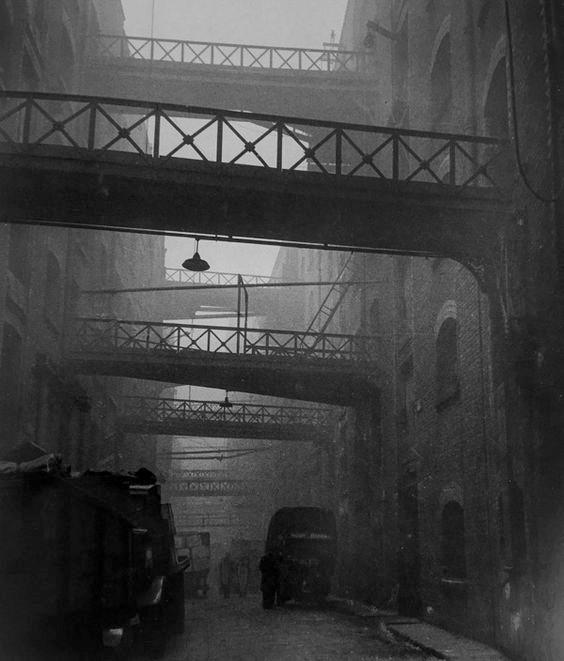 Shad Thames, a street between warehouses in Bermondsey c.1936.jpg