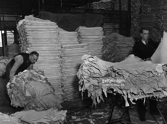 The Grange ,workers sorting crust leather at the leather works of James Garner & Sons in Bermondsey..jpg
