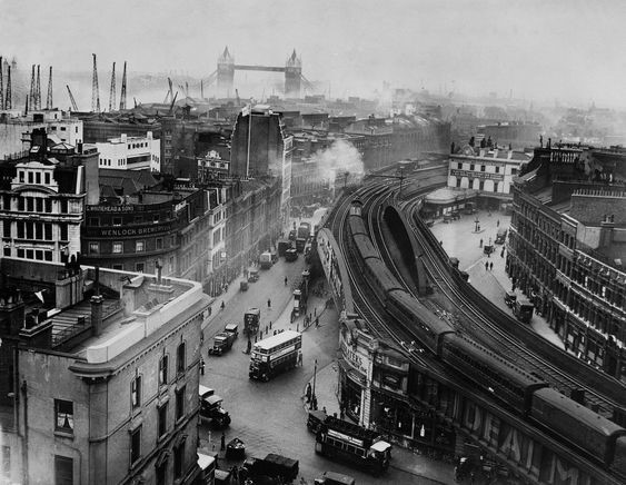 Tooley Street and a view towards Tower Bridge, London Bridge Train Station near Borough and Bermondsey with Hay's Wharf in the 1930's.jpg