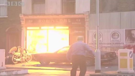 Eastenders being filmed in 2002 in Old Jamaica Road Bermondsey South East London England. The Old Robinson Bike Shop On Fire.jpg