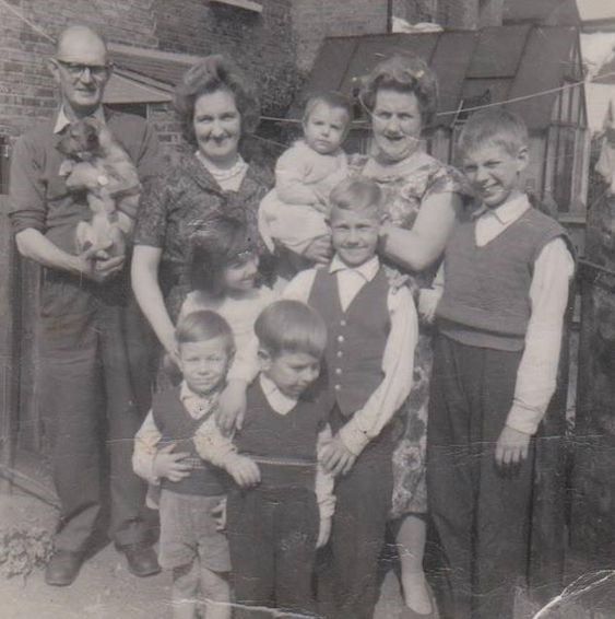 A Family in the back garden of a house in Blue Anchor Lane Bermondsey in 1960.jpg