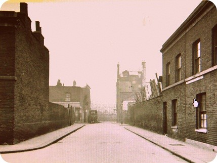 Looking towards Tabard Street from outside the Church, The Crown Pub can be seen on the far right and a builders yard between the houses and before the pub,.jpg