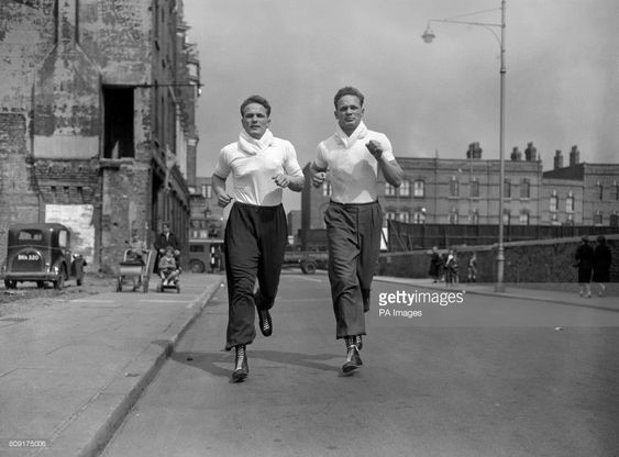 Albany Road, British boxer Henry Cooper - left) and his twin brother George during a training session at the Thomas a Becket gym on the Old Kent Road (background).jpg