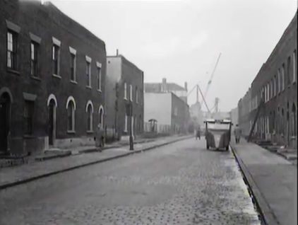 Bevington Street, the Milkman making deliveries with the roof line of Fountain House prominent in the centre distance. 1956.jpg