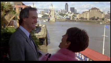 FILM A FISH CALLED WANDA 1988. Stars, John Cleese--Jamie Lee Curtis, Looking towards Tower Bridge and St. Katherine Docks.  X.jpg