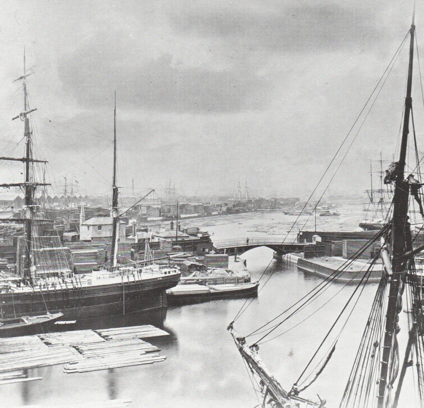 Norway Dock, with Lady Dock on the other side of the bridge, both floating timber. 1876. X.jpg