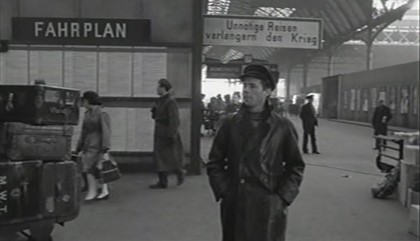 Film, The Password is Courage 1962. London Bridge Railway Station, the heavily disguised, Dirk Bogarde..jpg