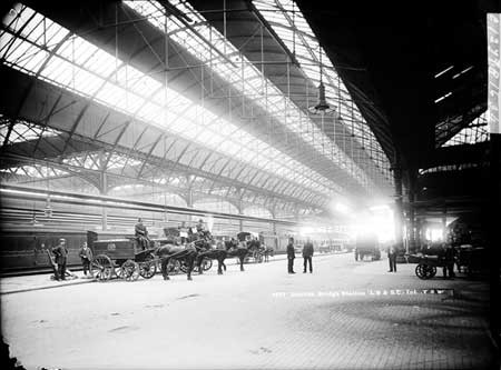 London Bridge Station with Royal Mail horse-drawn vehicles in the foreground. 1870 – 1900  X.jpg