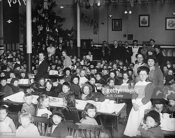 Old Kent Road c1919, children ready for a meal during a Waif's Festival at St George's.jpg