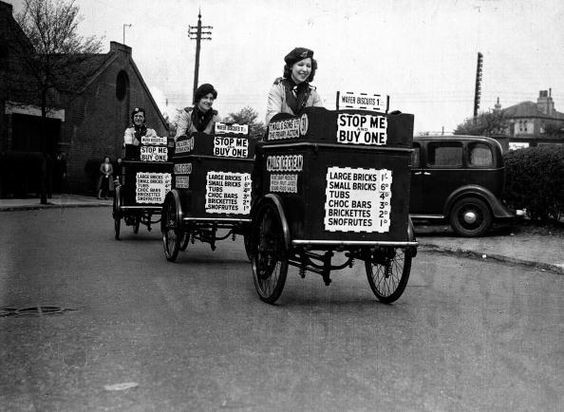 Three ice-cream girls set off on their rounds in London, they have taken over from men who have been called up to the services, 2nd May 1940.jpg