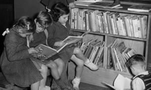 Spa Road, a group of children reading quietly in the 'Toddlers' Corner' of Bermondsey public library, 1950.jpg