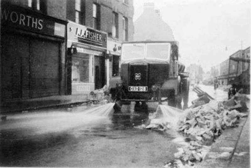 East Street Market – 1964 Washing down after the market has closed..jpg