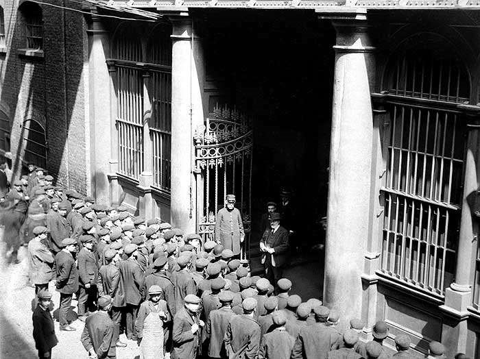 Tooley Street, men queue up to be taken on each day to work c1910..jpg