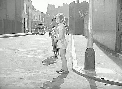 Film Adventure in the Hopfields 1954, this is looking along Ralph Street. The building with the white first floor frontage, seen behind the car, was the Duchess of Kent Pub 67 Deverell Street..jpg