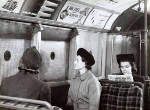 A wartime tube carriage with anti-splinter window netting..jpg