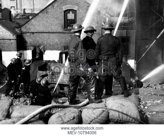 Grange Road, Firefighters at work at a fire at Young's Glue Factory in the Second World War, 12 October 1940..jpg