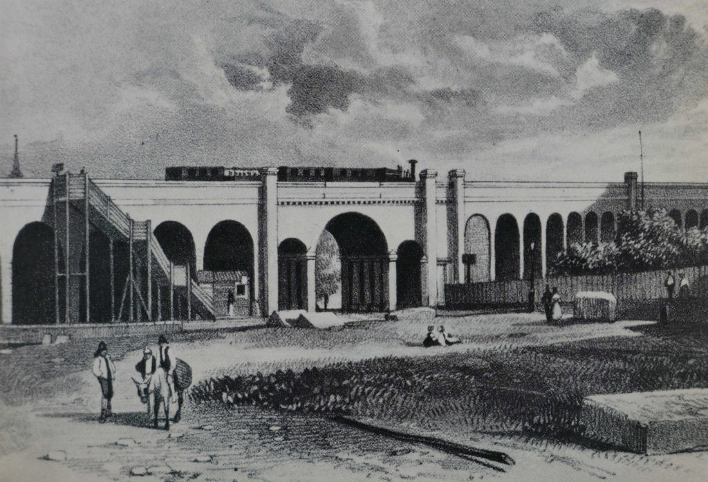 Spa Road 1836, tunnel underneath the viaduct with the stairs up to the station on the left. This is the view approaching the viaduct from the south..jpg