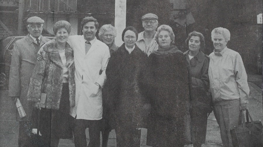 Mary Gibson's mother, also Mary Gibson, pictured third right, and aunt Nell Halstead, second left, pictured revisiting the Alaska fur factory in Bermondsey in 1988,both worked there at one time..jpg