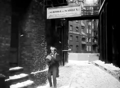 Film Scrooge 1951. Cathedral Street SE1 with St. Mary Overy's Wharf in the background.On Christmas morning, Bob Cratchit Mervyn Johns goes to find Scrooge after receiving a huge turkey from him.jpg