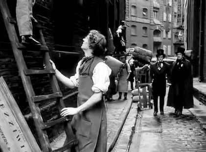 Film Scrooge 1951. Cathedral Street SE1 with St. Mary Overy's Wharf in the background.A young Ebenezer Scrooge George Cole and Jacob Marley Patrick Macnee approach their newly acquired pr.jpg