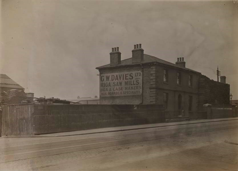Surrey Canal,G.W. Davies Ltd., box and case makers, on Blackhorse Bridge, Piles of their timber can seen above the property walls..jpg