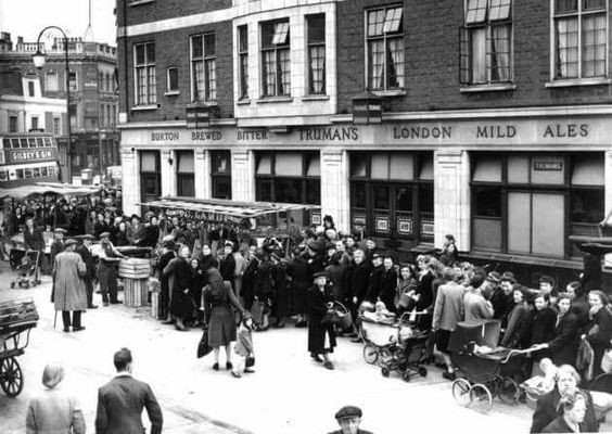 Westmorland Road Camberwell, 1947, The Red Lion pub. Housewives queuing for potatoes during rationing..jpg