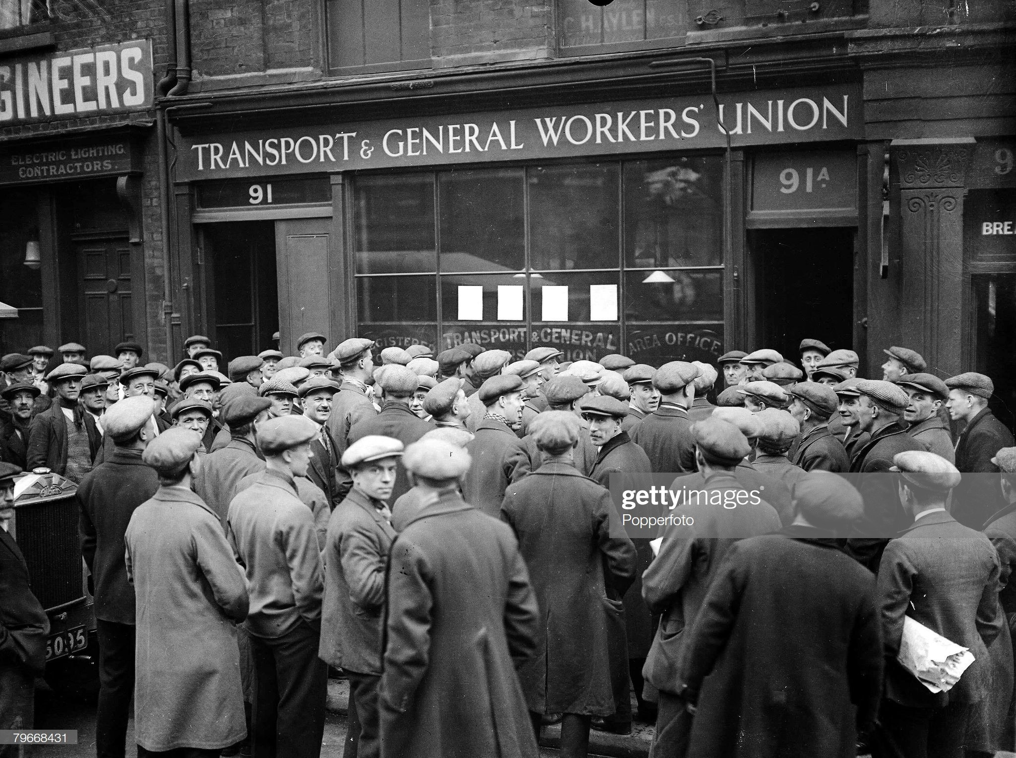 Tooley Street 1930, Striking shipyard workers gather outside the Transport & General Workers Union office during the dock strike. x.jpg