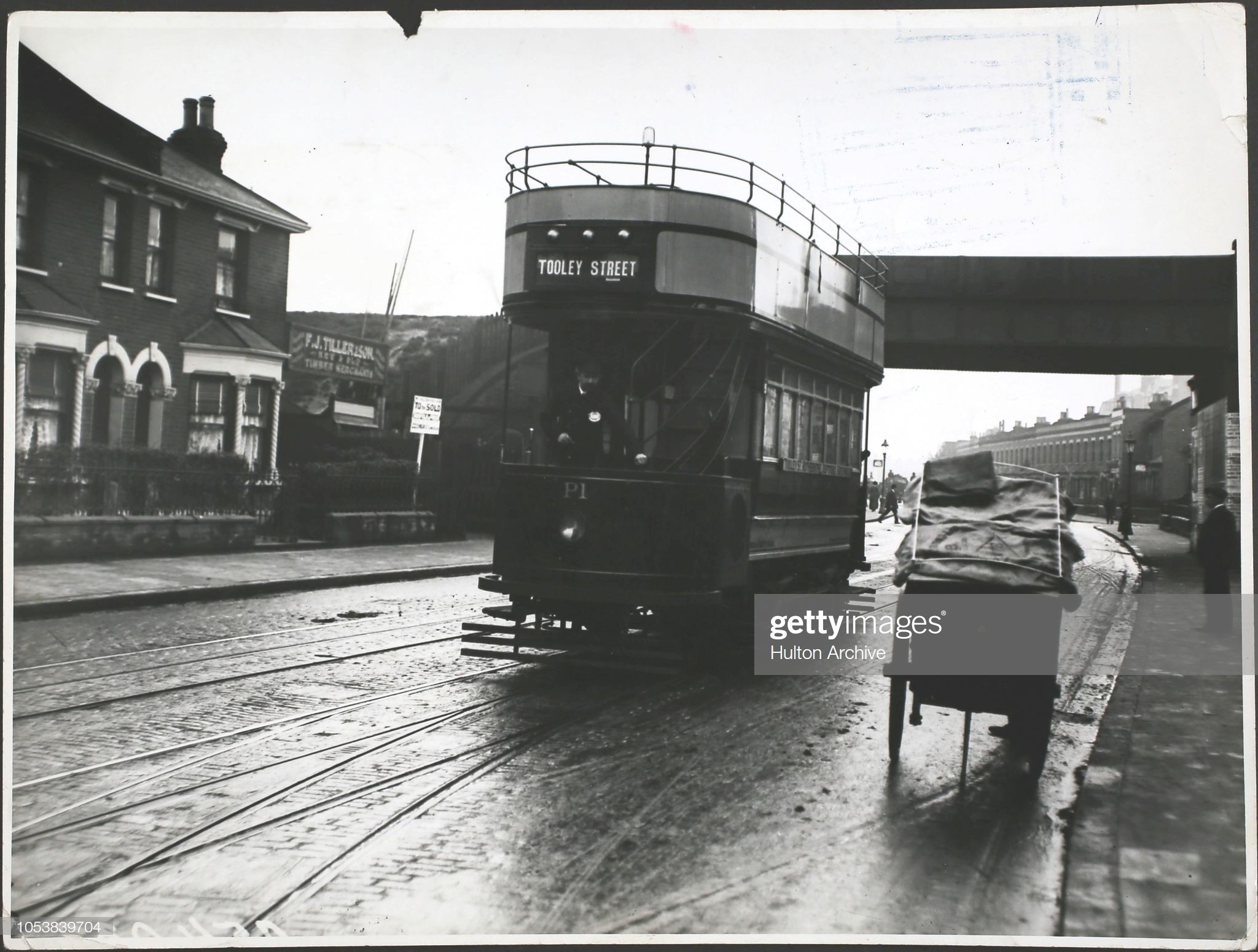 An LCC petrol-electric tram bound for Tooley Street in 1913. X.jpg