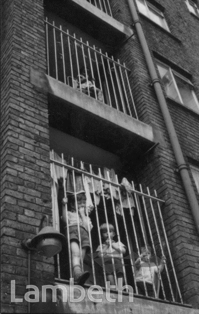 Coin Street, c1955, children on a stairwell of Edward Henry House.  X.png