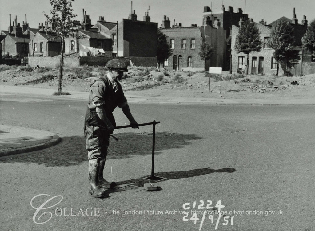 Spa Road Sewer, man conducts maintanence work 1951.  X.png