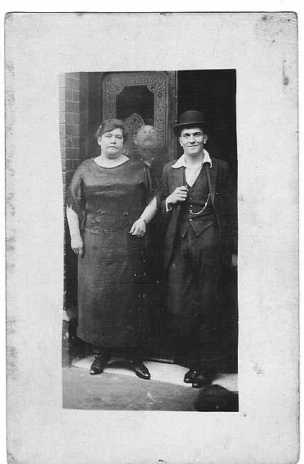 Wilson Grove, formally Salisbury Street. Eliza Tillson nee Bennett, proprietor of the Three Compasses and her son George Ernest Tillson 1922,outside the pub. X.png