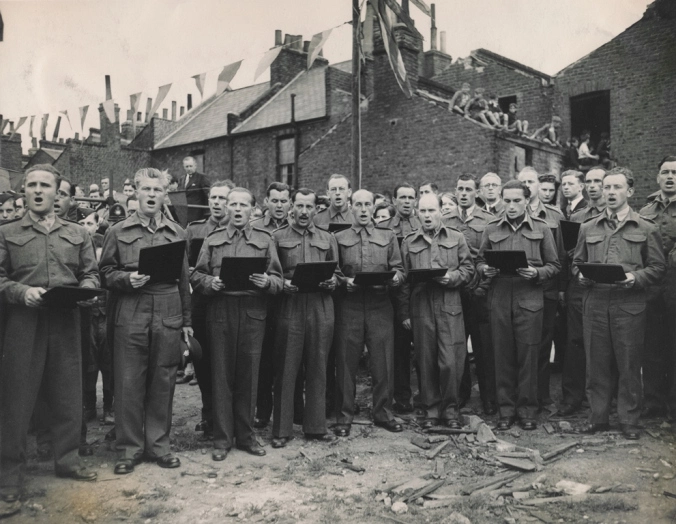 Spa Road,Czechoslovak servicemen sing at Bermondsey's Lidice memorial service,1943.  X.png