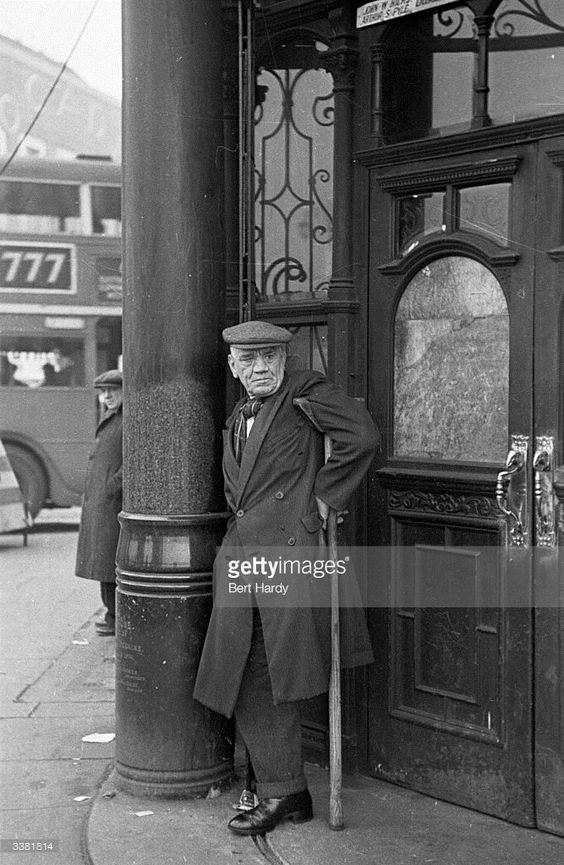 Elephant and Castle,1949. An elderly resident of Southwark resting outside a pub.  X.png